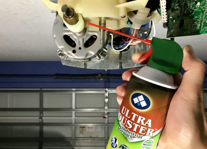 Dusting Linear garage door opener using canned air