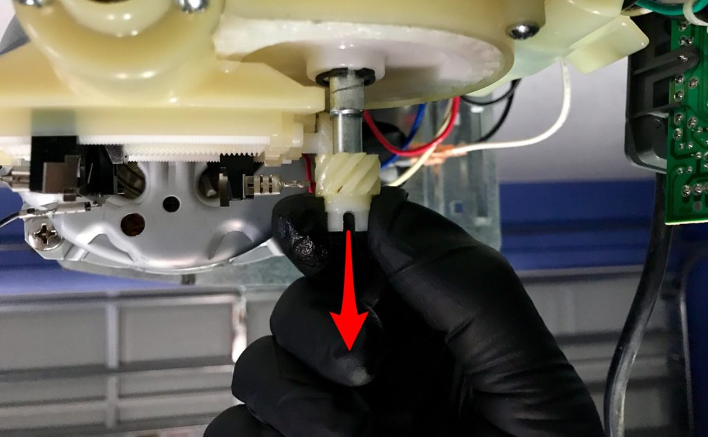 Remove the helical gear by simply pulling it off the drive shaft of Linear garaged door opener