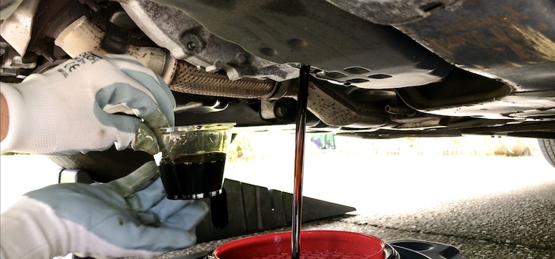 Nissan CVT transmission oil fluid sample taken to check for contamination by metal particles or clutch material